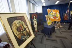 Recovered paintings are pictured during a news conference at FBI Headquarters in Los Angeles, California December 19, 2014.  REUTERS/Mario Anzuoni