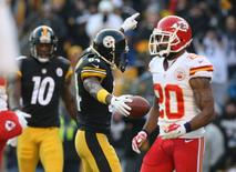 Dec 21, 2014; Pittsburgh, PA, USA; Pittsburgh Steelers wide receiver Antonio Brown (84) celebrates a touchdown against the Kansas City Chiefs during the second half at Heinz Field. The Steelers won the game, 20-12. Mandatory Credit: Jason Bridge-USA TODAY Sports