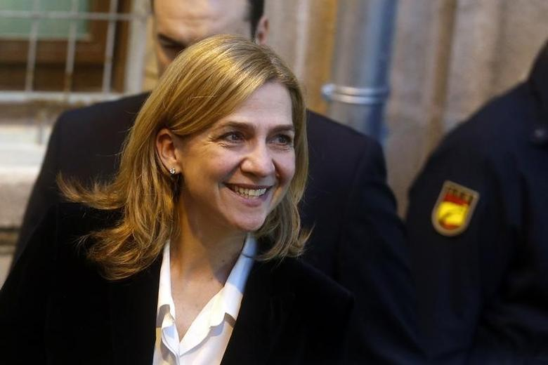 Spain's Cristina de Borbon, sister of the newly-crowned King Felipe VI, leaves a courthouse after testifying in front of judge Jose Castro over tax fraud and money-laundering charges in Palma de Mallorca February 8, 2014. REUTERS/Albert Gea