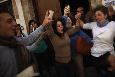 "Winners of Spain's Christmas Lottery ""El Gordo"" celebrate in El Gastor, near Cadiz, December 22, 2014.  REUTERS/Jon Nazca"