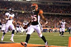 Dec 22, 2014; Cincinnati, OH, USA; Cincinnati Bengals running back Giovani Bernard (25) celebrates after scoring a touchdown during the third quarter against the Denver Broncos at Paul Brown Stadium. Andrew Weber-USA TODAY Sports