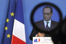 France's President Francois Hollande is seen through a camera filter during a news conference at a European Union leaders summit in Brussels December 18, 2014.  REUTERS/Pascal Rossignol