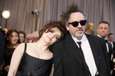 "British actress Helena Bonham Carter (L) rests her head on the shoulder of her partner director Tim Burton, nominee for Director of Best Animated Feature film  ""Frankenweenie,"" at the 85th Academy Awards in Hollywood, California February 24, 2013.  REUTERS/Lucy Nicholson"