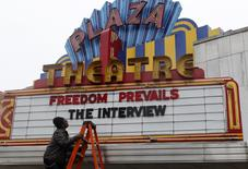 "General Manager Brandon Delaney looks up at the marquee sign after the announcement that the Plaza Theatre would be showing the movie  ""The Interview"" beginning Christmas Day in Atlanta, December 23, 2014. REUTERS/Tami Chappell"