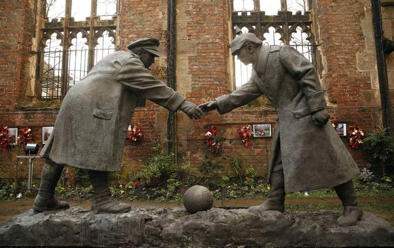 A resin sculpture, called ''All Together Now'', by artist Andrew Edwards, and depicting the Christmas Day football match between German and British soldiers fighting on the front line in World War One in 1914, is seen after being unveiled in the remains of St Luke's Church in Liverpool, northern England in this December 15, 2014 file photo. REUTERS/Phil Noble/Files