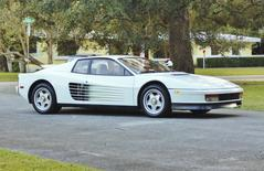 A white Ferrari Testarossa is seen in Miami, Florida, in this December 17, 2014, handout photo provided by Auto Pawn Plus.   REUTERS/Auto Pawn Plus/Handout