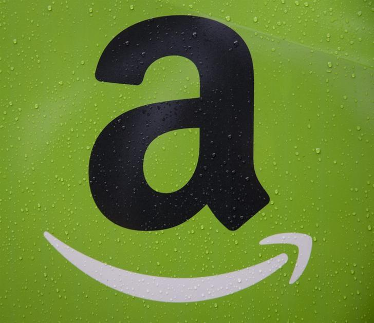 The Amazon.com, Inc. logo is seen on the side of a delivery truck in Brooklyn, New York October 23, 2014. REUTERS/Brendan McDermid