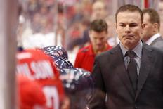 Washington Capitals head coach Adam Oates looks on from behind the bench against the Pittsburgh Penguins in the second period at Verizon Center. The Penguins won 4-0. Mandatory Credit: Geoff Burke-USA TODAY Sports