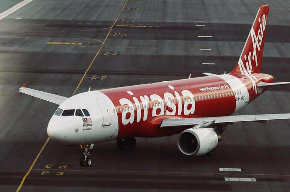 An AirAsia plane is seen on the runway at Kuala Lumpur International Airport in this August 19, 2014 file photo. REUTERS/Olivia Harris/Files