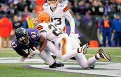 Dec 28, 2014; Baltimore, MD, USA; Baltimore Ravens wide receiver Torrey Smith (82) catches a touchdown pass against Cleveland Browns cornerback Buster Skrine (22) in the fourth quarter at M&T Bank Stadium. Mandatory Credit: Evan Habeeb-USA TODAY Sports
