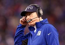 New York Giants head coach Tom Coughlin reacts while wearing a NYPD cap against the Philadelphia Eagles during the fourth quarter at MetLife Stadium. editThe Eagles defeated the Giants 34-26. Mandatory Cr: Brad Penner-USA TODAY Sports - Dec 28, 2014; East Rutherford, NJ, USA;