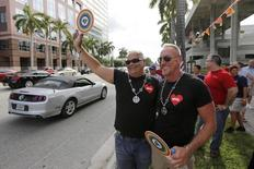 Terry Decarlo (L) and Bill Huelsman of Wilton Manors take part in a rally by gay rights activists following the U.S. Supreme Court's 5-4 ruling, striking down as unconstitutional the Defense of Marriage Act (DOMA), in Fort Lauderdale, Florida June 26, 2013.  REUTERS/Joe Skipper