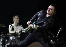 Lead singer Bono of the rock band U2 performs during the opening night of the North American leg of their 360 degree tour at Soldier Field in Chicago, in this file photo taken September 12, 2009. Bono, who was injured in a cycling accident last year, said on January 2, 2015, his recovery has not been easy and he may never play guitar again. REUTERS/Jeff Haynes/Files