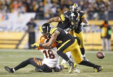 Pittsburgh Steelers free safety Mike Mitchell (23) hits Cincinnati Bengals wide receiver A.J. Green (18) causing Green to fumble during the fourth quarter at Heinz Field. The Steelers won 27-17. Mandatory Credit: Charles LeClaire-USA TODAY Sports