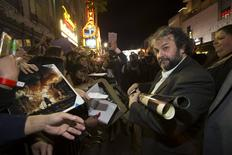 "Writer, producer and director of the movie Peter Jackson signs autographs at the premiere of ""The Hobbit: The Battle of the Five Armies"" at Dolby theatre in Hollywood, California December 9, 2014. REUTERS/Mario Anzuoni"