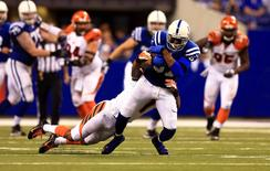 Indianapolis Colts wide receiver Reggie Wayne (87) is tackled by Cincinnati Bengals cornerback Darqueze Dennard (21)  during the second half in the 2014 AFC Wild Card playoff football game at Lucas Oil Stadium. Mandatory Credit: Andrew Weber-USA TODAY Sports