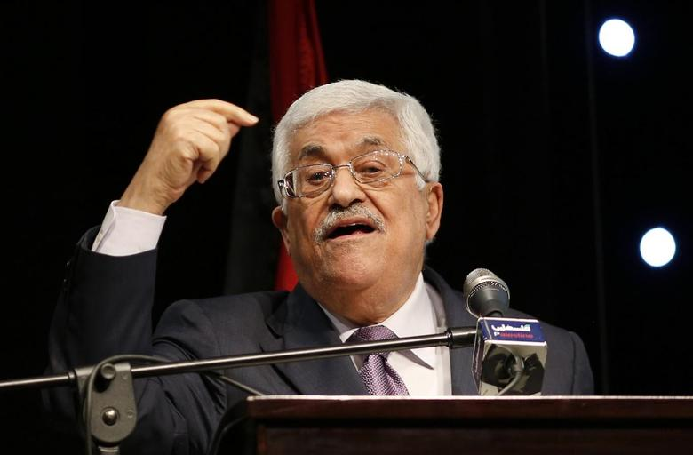 Palestinian President Mahmoud Abbas gestures as he speaks during the opening ceremony of the ''Jerusalem in Memory'' exhibition in the West Bank city of Ramallah January 4, 2015. REUTERS/Mohamad Torokman