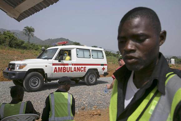 An ambulance transporting a newly admitted Ebola patient drives to the entrance of the Save the Children Kerry Town Ebola treatment centre outside Freetown, Sierra Leone, December 22, 2014. REUTERS/Baz Ratner