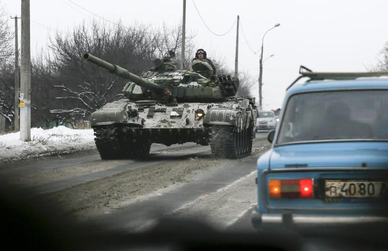 Pro-Russian separatists ride on a tank at the town of Khartsyzk, east of Donetsk, December 7, 2014. REUTERS/Maxim Shemetov