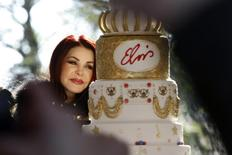Priscilla Ann Presley, the ex-wife of the late singer Elvis Presley, cuts a birthday cake during a proclamation of Elvis Presley Day by Memphis and Shelby County officials at Graceland in Memphis, Tennessee, January 8, 2015. REUTERS/Karen Pulfer Focht