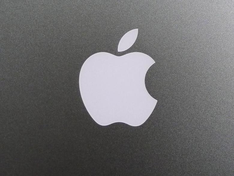 The Apple Inc corporate logo is pictured on the rear side of the company's Macbook Air notebook computer in Virginia, August 10, 2011. REUTERS/Jason Reed/Files