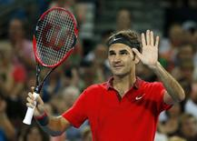 Roger Federer of Switzerland acknowledges the crowd after defeating James Duckworth of Australia in their men's singles quarter-final match at the Brisbane International tennis tournament in Brisbane, January 9, 2015.  REUTERS/Jason Reed