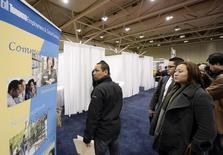 Visitors stand in line during  the 2014 Spring National Job Fair and Training Expo in Toronto, April 3, 2014. REUTERS/Aaron Harris