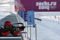 """Alexander Loginov of Russia takes part in a biathlon training session for the 2014 Sochi Winter Olympic Games at the """"Laura"""" cross-country and biathlon centre in Rosa Khutor February 5, 2014. REUTERS/Stefan Wermuth"""
