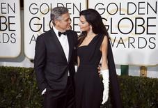 George e Amal Clooney no tapete vermelho do Globo do Ouro. 11/01/2015 REUTERS/Danny Moloshok