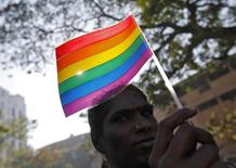 "A participant holds a rainbow flag during ""Queer Azadi Mumbai 2011"" (Queer Freedom Mumbai 2011), a parade for gay and lesbian rights, in Mumbai January 29, 2011. REUTERS/Danish Siddiqui"