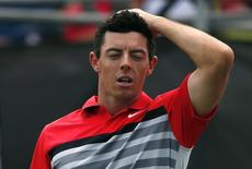 World number one and defending champion Rory McIlroy of Northern Ireland reacts after finishing his fourth and final round of the Australian Open golf tournament at The Australian Golf Club in Sydney November 30, 2014.    REUTERS/David Gray