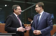 European Central Bank (ECB) President Mario Draghi and European Euro and Social Dialogue Commissioner Valdis Dombrovskis (R) attend a euro zone finance ministers meeting in Brussels December 8, 2014.   REUTERS/Francois Lenoir