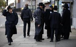 Jewish men talk in Golders Green, London, January 10, 2015. REUTERS/Paul Hackett