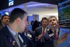 Traders work on the floor of the New York Stock Exchange January 13, 2015. REUTERS/Brendan McDermid