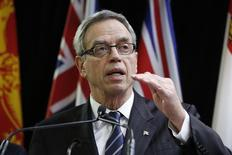Canada's Finance Minister Joe Oliver speaks to journalists before the start of a meeting with his provincial and territorial counterparts in Ottawa December 15, 2014. REUTERS/Chris Wattie