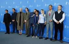 "Actors Willem Dafoe, Edward Norton, Tilda Swinton, director Wes Anderson, Ralph Fiennes, Tony Revolori, Saoirse Ronan, Jeff Goldblum and Bill Murray  (L-R) pose to promote the movie ""The Grand Budapest Hotel"" at the 64th Berlinale International Film Festival in Berlin February 6, 2014.  REUTERS/Tobias Schwarz"