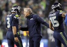 January 10, 2015; Seattle, WA, USA; Seattle Seahawks head coach Pete Carroll, wide receiver Jermaine Kearse (15) and quarterback Russell Wilson (3) celebrate during the 31-17 victory against the Carolina Panthers in the second half in the 2014 NFC Divisional playoff football game at CenturyLink Field. Mandatory Credit: Joe Nicholson-USA TODAY Sports