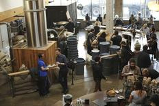 People gather at Sightglass Coffee in the South of Market (SoMA) neighborhood in San Francisco, California January 14, 2015. REUTERS/Robert Galbraith