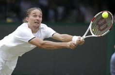 Alexandr Dolgopolov of Ukraine hits a return against Grigor Dimitrov of Bulgaria during their men's singles tennis match on Court 1 at the Wimbledon Tennis Championships in London June 27, 2014. REUTERS/Max Rossi