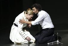 German tenor Jonas Kaufmann (R) performs as Lohengrin and German soprano Annette Dasch performs as Elsa von Brabant during their rehearsal of the opera ''Lohengrin'' by Richard Wagner in Bayreuth, southern Germany in this July 17, 2010 file photo. REUTERS/Michaela Rehle/Files