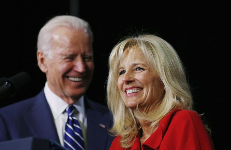 Vice President Joe Biden and Dr. Jill Biden smile onstage while speaking about community college education during a visit to Pellissippi State College in Knoxville, Tennessee January 9, 2015.  REUTERS/Kevin Lamarque