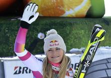 Lindsey Vonn of the U.S. waves before the podium celebration after winning the women's World Cup Downhill skiing race in Cortina D'Ampezzo January 18, 2015. REUTERS/Stringer