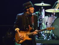 E-Street Band member Nils Lofgren performs at a concert with Bruce Springsteen (unseen) in Stockholm in this May 3, 2013 file photo.  REUTERS/Henrik Montgomery/Scanpix Sweden/Files