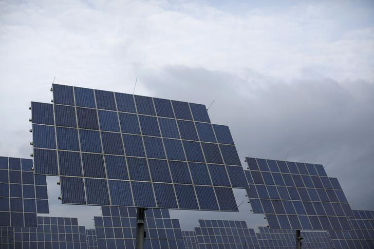 Solar panels are seen under a cloudy sky in Bad Hersfeld May 14, 2013. REUTERS/Lisi Niesner