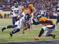Lance do jogo entre Seattle Seahawks e Denver Broncos no Super Bowl, em East Rutherford, Nova Jersey, Estados Unidos, em fevereiro do ano passado. 02/02/2014 REUTERS/Carlo Allegri