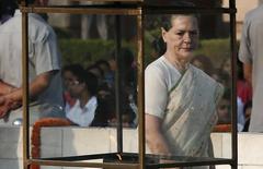 India's Congress Party chief Sonia Gandhi walks after paying homage at the Mahatma Gandhi memorial on the 145th birth anniversary of Mahatma Gandhi at Rajghat in New Delhi October 2, 2014. REUTERS/Adnan Abidi