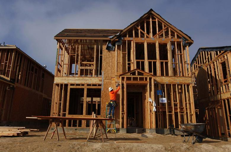 A construction worker is seen building single family homes in San Diego, California, in this file photo taken March 25, 2013. REUTERS/Mike Blake/Files