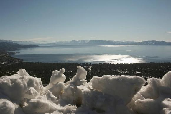 Plowed snow forms a frame for Lake Tahoe near Reno, Nevada February 3, 2012. REUTERS/Robert Galbraith