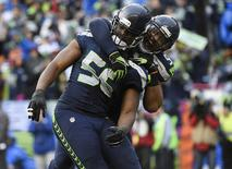 January 18, 2015; Seattle, WA, USA; Seattle Seahawks defensive end Cliff Avril (56) celebrates with middle linebacker Bobby Wagner (54) after he sacks Green Bay Packers quarterback Aaron Rodgers (not pictured) during the second half in the NFC Championship game at CenturyLink Field. Kyle Terada-USA TODAY Sports -