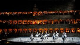"Horses and riders perform on stage during a dress rehearsal of Wolfgang Amadeus Mozart's cantata ""Davide penitente"" in Salzburg January 20, 2015.  REUTERS/Dominic Ebenbichler (AUSTRIA - Tags: SOCIETY ANIMALS)"